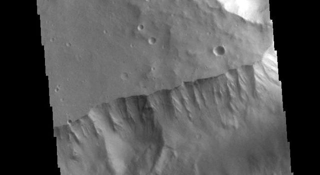 The steep sided depression in this image captured by NASA's 2001 Mars Odyssey spacecraft is Shalbatana Vallis, a channel located in Xanthe Terra.