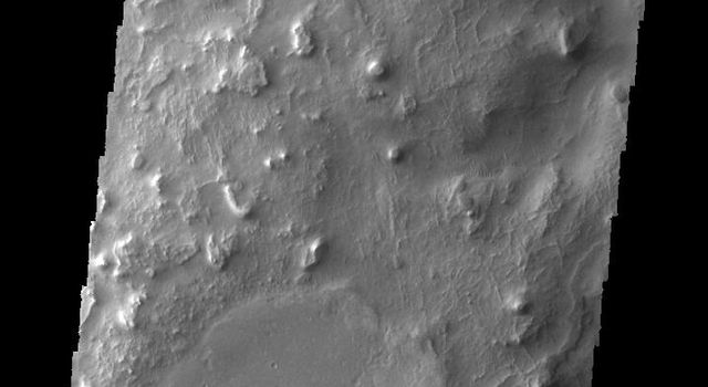This image captured by NASA's 2001 Mars Odyssey spacecraft shows a portion of Huo-Hsing Vallis, located near the northern margin of Terra Sabaea.