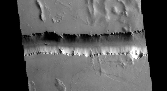 This image captured by NASA's 2001 Mars Odyssey spacecraft shows a small portion of Olympica Fossae. Olympica Fossae is located on volcanic plains between Alba Mons and Olympus Mons.