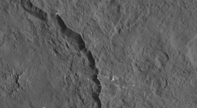 Dantu crater on Ceres, seen in this image from NASA's Dawn spacecraft at left, reveals structures hinting at tectonic processes that formed the dwarf planet's surface. Linear structures are spread over the crater floor.