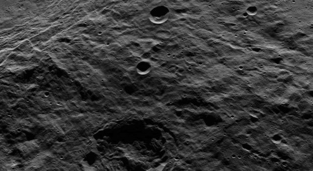 The terraced rim of the large crater named Urvara can be seen at the upper left in this view from Ceres. This image from NASA's Dawn spacecraft shows terrain in the southern hemisphere of the dwarf planet.