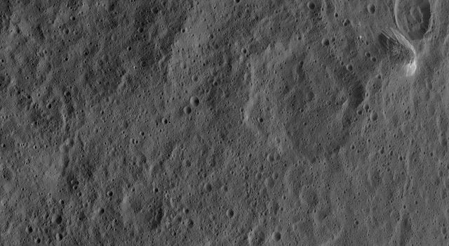 The tall, cone-shaped mountain Ahuna Mons is seen in this image taken by NASA's Dawn spacecraft. Ahuna Mons taken on Oct. 14, 2015.