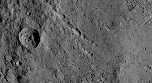 This view from NASA's Dawn spacecraft shows different types of terrain located side by side on Ceres: a smooth terrain at right with numerous small impact craters, and a less-cratered, hummocky terrain at left.