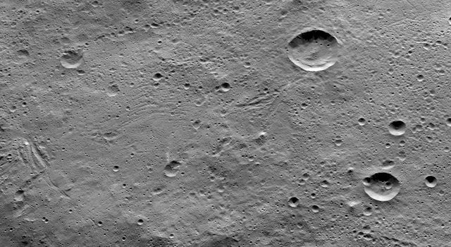 This image of Ceres, taken by NASA's Dawn spacecraft, shows terrain in the southern hemisphere within the large crater called Yalode. The prominent crater at top-right is called Lono. The crater directly below it is called Besua.
