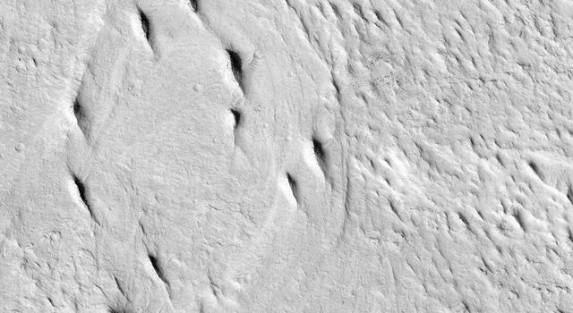 This image from NASA's Mars Reconnaissance Orbiter spacecraft contains interesting examples of crosscutting, sinuous and straight ridges. Both ridges may be ancient river deposits.