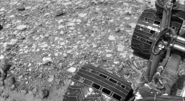 NASA's Curiosity Mars rover used its Navigation Camera (Navcam) to capture this view partway back down a slope it climbed toward 'Marias Pass' on lower Mount Sharp. The image was taken May 22, 2015.