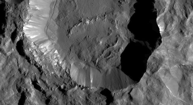 Kupalo Crater, taken Dec. 21, 2016 by NASA's Dawn spacecraft, shows one of the youngest craters on Ceres. The crater has bright material exposed on its rim and walls, which could be salts. Its flat floor likely formed from impact melt and debris.