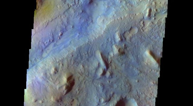 The THEMIS camera contains 5 filters. The data from different filters can be combined in multiple ways to create a false color image. This image captured by NASA's 2001 Mars Odyssey spacecraft shows part of Nili Fossae.