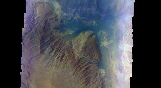 The THEMIS camera contains 5 filters. The data from different filters can be combined in multiple ways to create a false color image. This false image from NASA's 2001 Mars Odyssey spacecraft shows part of Ophir Chasma.