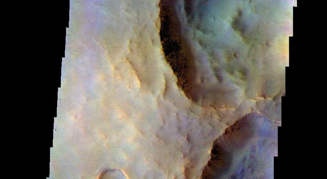 The THEMIS camera contains 5 filters. The data from different filters can be combined in multiple ways to create a false color image. This image captured by NASA's 2001 Mars Odyssey spacecraft shows a group of unnamed craters north of Fournier Crater.
