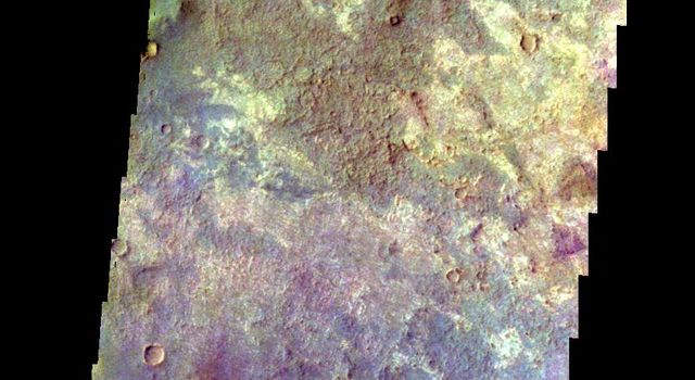The THEMIS camera contains 5 filters. The data from different filters can be combined in multiple ways to create a false color image. This image from NASA's 2001 Mars Odyssey spacecraft shows a variety of surface materials in the plains of Sabaea Terra.