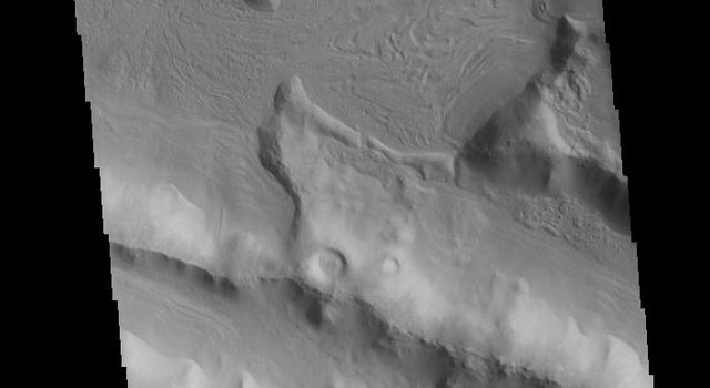 This image captured by NASA's 2001 Mars Odyssey spacecraft shows a small portion of the boundary region between Terra Sabaea and Utopia Planitia.
