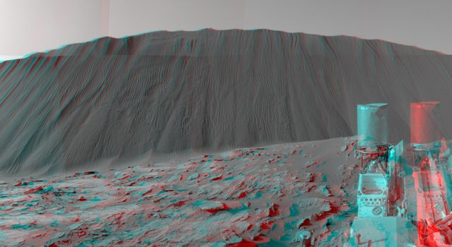 This stereo view from NASA's Curiosity Mars Rover, taken on Dec. 17, 2015, shows the downwind side of a dune about 13 feet high within the Bagnold Dunes on Mars. You need 3-D glasses to view this image.