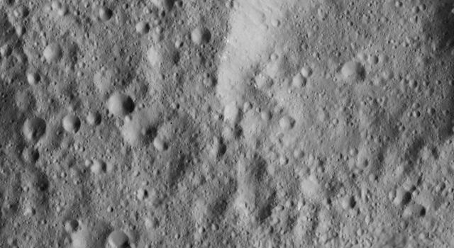 This view from NASA's Dawn spacecraft captured on Dec. 21, 2015 shows a portion of the northern hemisphere of Ceres. Bright material can be seen in the wall of the large crater at upper right.