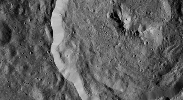 Tupo Crater on Ceres is seen in this view from NASA's Dawn spacecraft. This crater, located in the southern hemisphere of Ceres, was named for the Polynesian god of turmeric. Dawn captured the scene on Dec. 24, 2015.