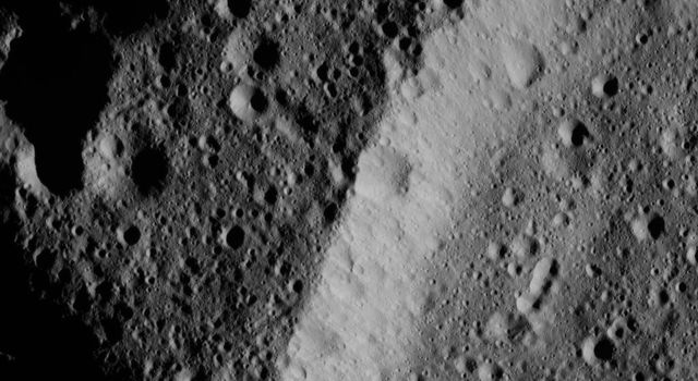 This image, taken by NASA's Dawn spacecraft, shows the heavily cratered rim of an older, unnamed impact feature on Ceres. The crater density is almost the same inside and outside, and its wall is also quite battered by impacts.