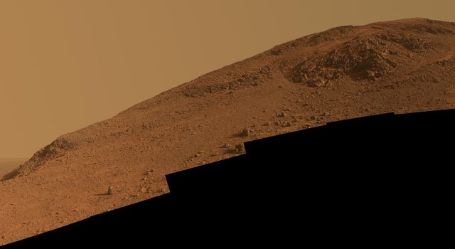 This scene from NASA's Mars Exploration Rover Opportunity looks upward at 'Knudsen Ridge' on the southern edge of 'Marathon Valley' from inside the valley.