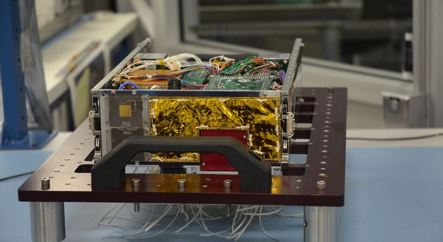 One of the two MarCO (Mars Cube One) CubeSat spacecraft, with its insides displayed, is seen at NASA's Jet Propulsion Laboratory, Pasadena, California.