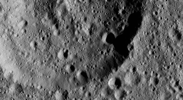This ancient crater on Ceres displays a flattened floor and a low, rounded central peak. NASA's Dawn spacecraft captured the scene on Jan. 2, 2016.