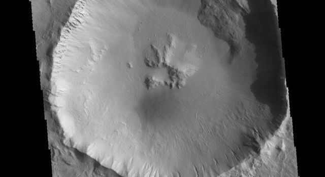 This image captured by NASA's 2001 Mars Odyssey spacecraft shows an unnamed crater located northwest of Elysium Mons. This crater contains a central pit, which formed at the time of impact.