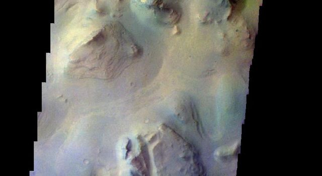 The THEMIS camera contains 5 filters. The data from different filters can be combined in multiple ways to create a false color image. This image from NASA's 2001 Mars Odyssey spacecraft shows a region of chaos in Eos Chasma.