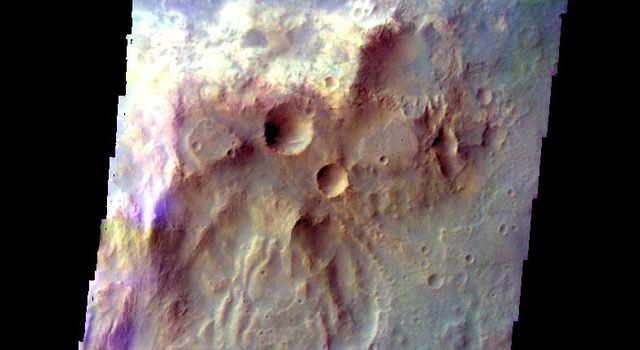 The THEMIS camera contains 5 filters. The data from different filters can be combined in multiple ways to create a false color image. This image from NASA's 2001 Mars Odyssey spacecraft shows a hill in Tyrrhena Terra.