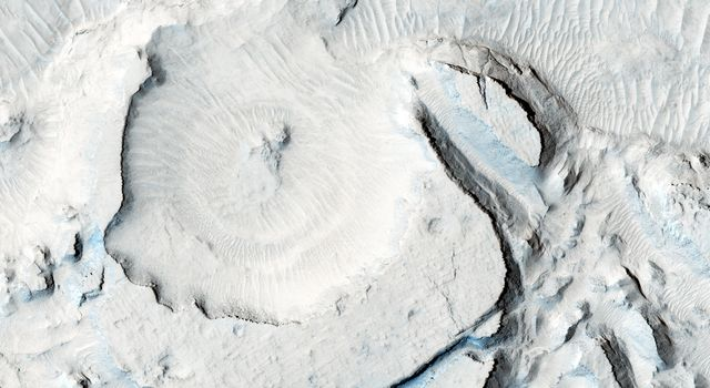 NASA's Mars Reconnaissance Orbiter spacecraft captured these rounded, mysterious mounds occur along the floor of a depression in northern Arabia Terra.
