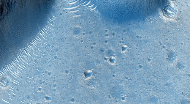 This image from NASA's Mars Reconnaissance Orbiter spacecraft shows the northern rim of a crater in Deuteronilus. At the northern end, we see the crater rim and ridges inside and below that rim.
