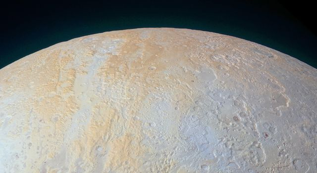 The Frozen Canyons of Pluto