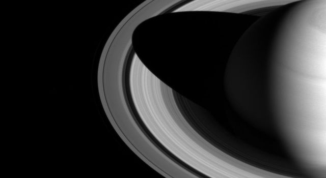 The shadow of Saturn on the rings, which stretched across all of the rings earlier in NASA's Cassini's mission, now barely makes it past the Cassini division.