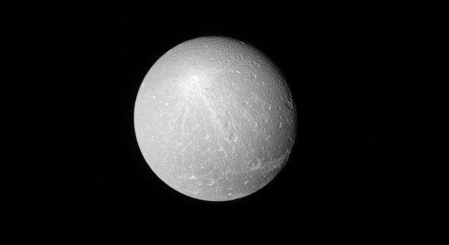 When viewed from a distance with the sun directly behind NASA's Cassini, the larger, brighter craters really stand out on moons like Dione. Among these larger craters, some leave bright ray patterns across the moon.