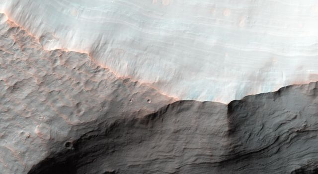 Alluvial fans are gently-sloping wedges of sediments deposited by flowing water. Some of the best-preserved alluvial fans on Mars are in Saheki Crater, seen here by NASA's Mars Reconnaissance Orbiter spacecraft.