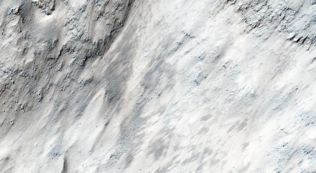 This image from NASA's Mars Reconnaissance Orbiter covers part of the chaotic terrain in Masursky Crater, and was targeted due to evidence that ejecta from Mojave Crater, to the south, may have modified the landscape.