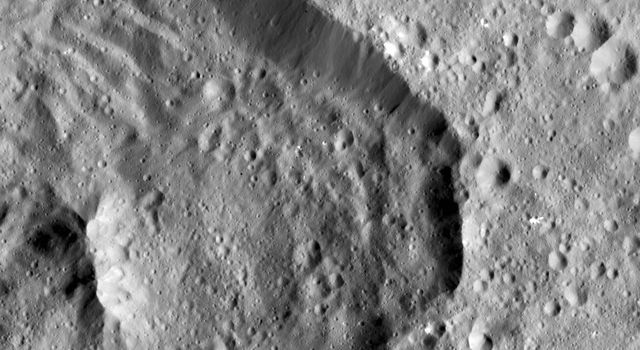 Achita Crater on Ceres was named for the Nigerian god of agriculture. NASA's Dawn spacecraft took this image of the crater on January 15, 2016. Achita is located in the northern hemisphere.