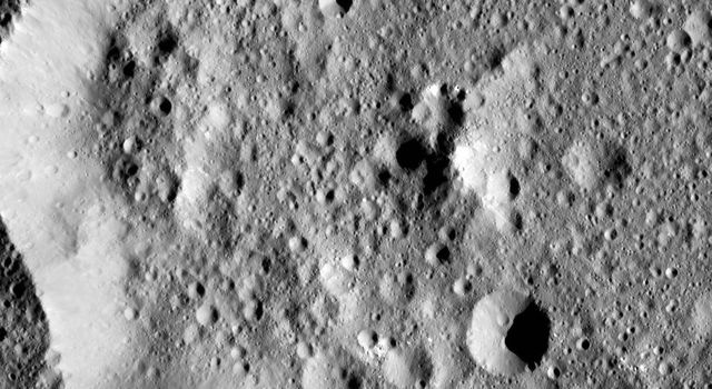 Ernutet Crater is featured in this image from Ceres, taken by NASA's Dawn spacecraft. Ernutet was named for the Egyptian cobra-headed goddess of the harvest. The crater measures about 32 miles (52 kilometers) in diameter and is located in the northern hem