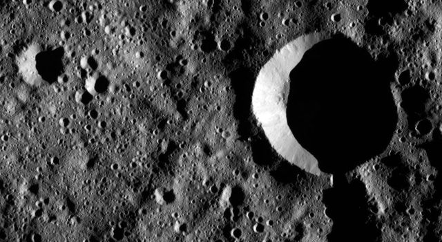 Zadeni Crater, at 80 miles (128 kilometers) wide, is a prominent impact feature in the southern hemisphere of Ceres. This image from NASA's Dawn spacecraft shows terrain in Zadeni's interior, which hosts numerous smaller craters.