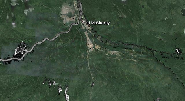 The wildfire that devastated Fort McMurray in May 13, 2016 and forced the evacuation of an additional 12,000 residents in the area is seen in this image from NASA's Terra spacecraft.