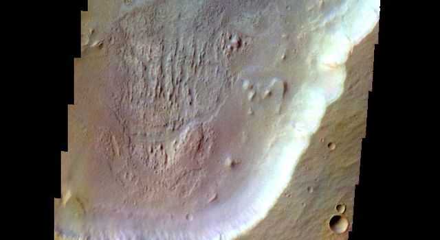 The THEMIS camera contains 5 filters. The data from different filters can be combined in multiple ways to create a false color image. This image from NASA's 2001 Mars Odyssey spacecraft shows part of Peraea Cavus.