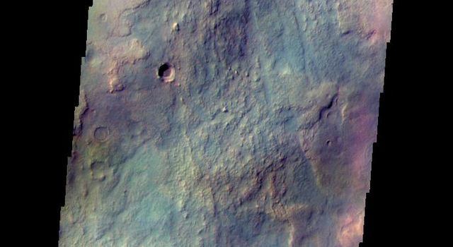 The THEMIS camera contains 5 filters. Data from different filters can be combined in many ways to create a false color image. This image from NASA's 2001 Mars Odyssey spacecraft shows multiple textures of the plains located northwest of the Argyre basin.