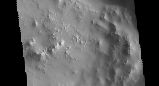This image captured by NASA's 2001 Mars Odyssey spacecraft shows an unnamed crater in Terra Sabaea.