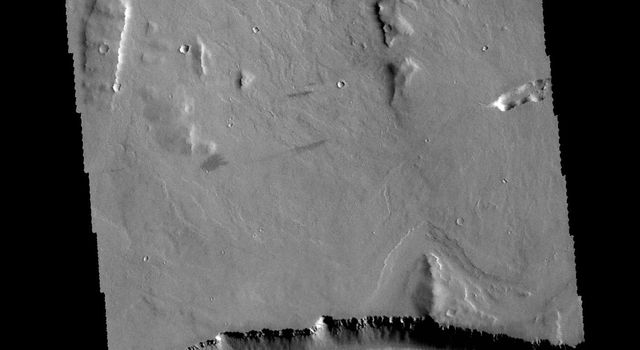 This image captured by NASA's 2001 Mars Odyssey spacecraft shows part of Olympica Fossae.