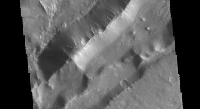 This image captured by NASA's 2001 Mars Odyssey spacecraft shows parallel sets of depressions.