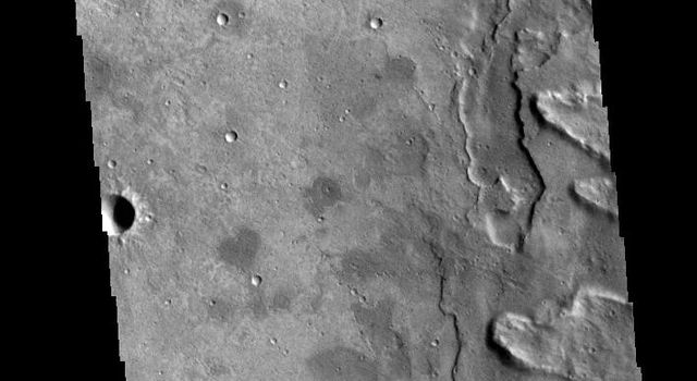 This image captured by NASA's 2001 Mars Odyssey spacecraft shows a small portion of Yuty Crater's ejecta blanket.