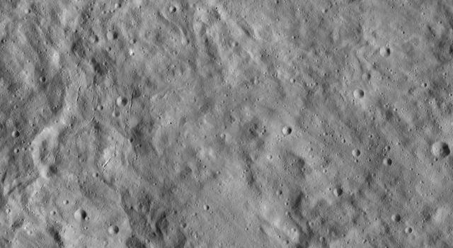 This image from NASA's Dawn spacecraft shows a portion of Ceres known as Erntedank Planum, a broad plateau 345 miles (555 kilometers) wide. The terrain seen here lies just to the southeast of Occator Crater, home of Ceres' brightest region.