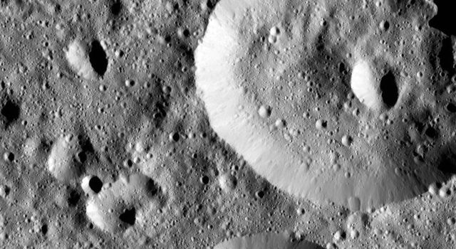 This image captured by NASA's Dawn spacecraft shows small craters within Meanderi Crater on Ceres, which measures 64 miles (103 kilometers) in diameter.