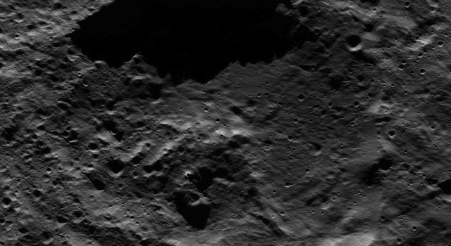 This picture from NASA's Dawn spacecraft shows a crater within the floor of the Mondamin impact basin, which lies in the southern hemisphere of Ceres.