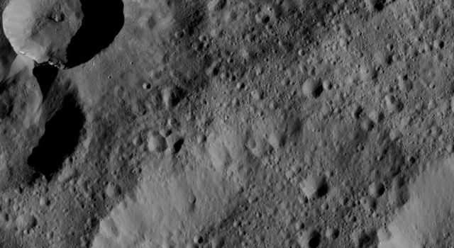 This image from NASA's Dawn spacecraft shows an area in the northern hemisphere of Ceres. At upper left, material from the rim of a fresher crater appears to have slumped into its neighbor.