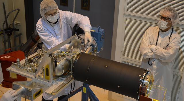 Technicians inspect the cooler for the Mid-Infrared Instrument, or MIRI, part of NASA's James Webb Space Telescope.