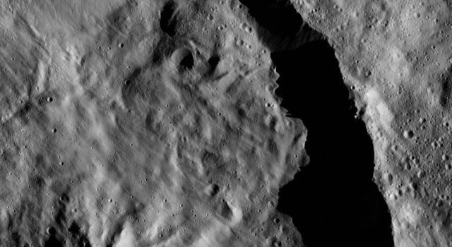 Datan Crater is featured in this scene from Ceres captured by NASA's Dawn spacecraft. Datan is imprinted on the older Geshtin Crater, whose terrain fills the rest of the view.