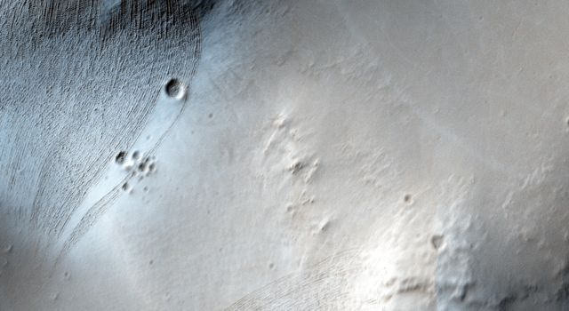 This observation from NASA's Mars Reconnaissance Orbiter spacecraft is of Noctis Labyrinthus, a highly tectonized region immediately to the west of Valles Marineris. It formed when Mars' crust stretched itself apart.